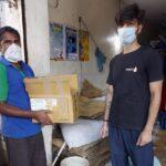 Rahul Khatri handing over essentials kit to ice cream vendor in Delhi